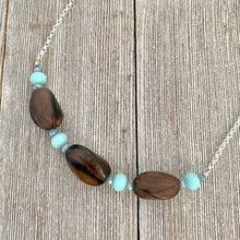 Load image into Gallery viewer, Tiger Ebony Necklace with Light Turquoise and Grey Crystals on a Silver Plated Chain