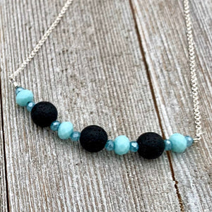 Three Black Lava Beads, Turquoise and Blue Crystals, Diffuser Necklace