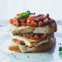 Roasted tomato and olive tapenade bruschetta