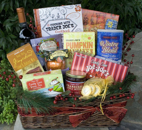 gift basket with greenery and boxes and containers of Trader Joe's products