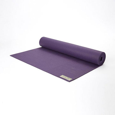 purple yoga mat partially unrolled