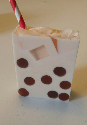 brown polka dotted soap with a striped straw