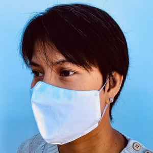 Woman wearing washable and reusable 100% cotton face mask