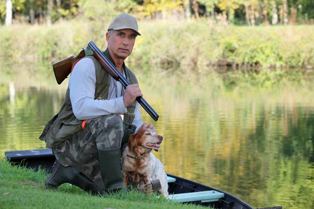 What safety precautions should you take when hunting on a boat?