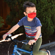 Load image into Gallery viewer, Boy Riding Bike with Mask from The Universal Mask