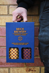 Two 375ml bottles from Brick Brewery's Winterberry Sour Range in blue packaging