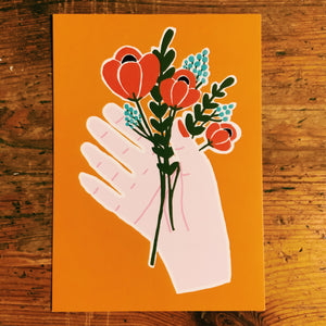 Orange Hand holding flowers postcard