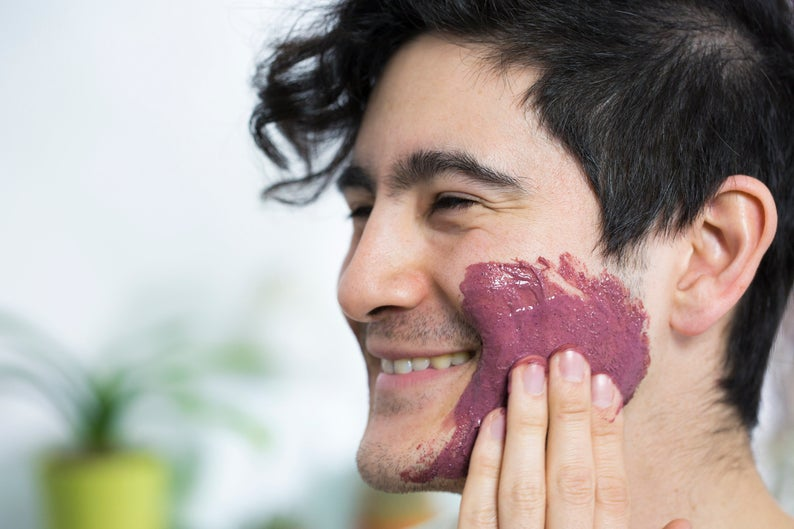 Man applying SCHMEAR Naturals Antioxidant Skincare