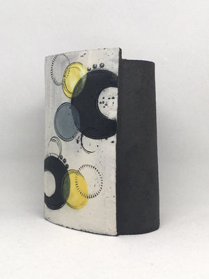 Small Wrap pot- Textured black with black crescents with grey and yellow circles