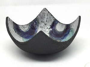 Bowl - Textured black with many blue circles and purple crescents