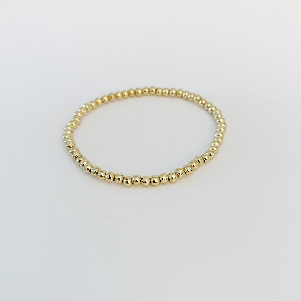 Gold bead round name bracelet