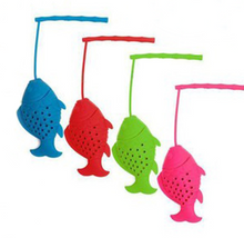Load image into Gallery viewer, Tiny Tots Silicone Fish Tea Infuser Fill this cute fish tea infuser with your favourite Tiny Tots loose leaf tea and watch him swim about and your tea come alive!  Choose from 4x different Colours: Pink, Blue, Green, Red  Dishwasher Safe 100% food-grade silicone Eco-friendly, non-toxic. Loose leaf tea infuser. Fun fish loose leaf tea infuser. Water infuser