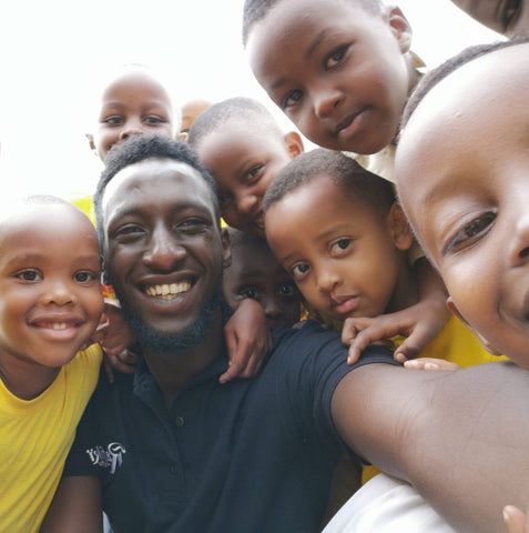 Benjamin Murenzi with kids