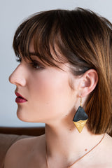 Model wearing SULTRY recycled leather earrings