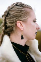 Model wearing SADDLE UP Recycled Leather Tassel Earrings
