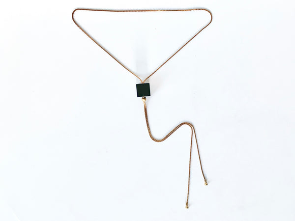 Black cube bolo tie necklace with round brass bolo tips