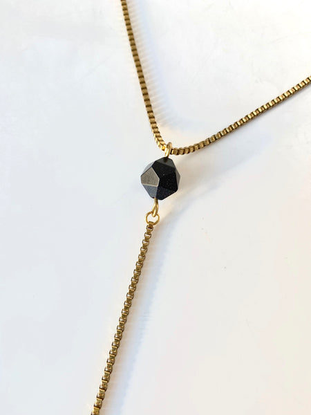 Blue goldstone pendant of gold lariat necklace