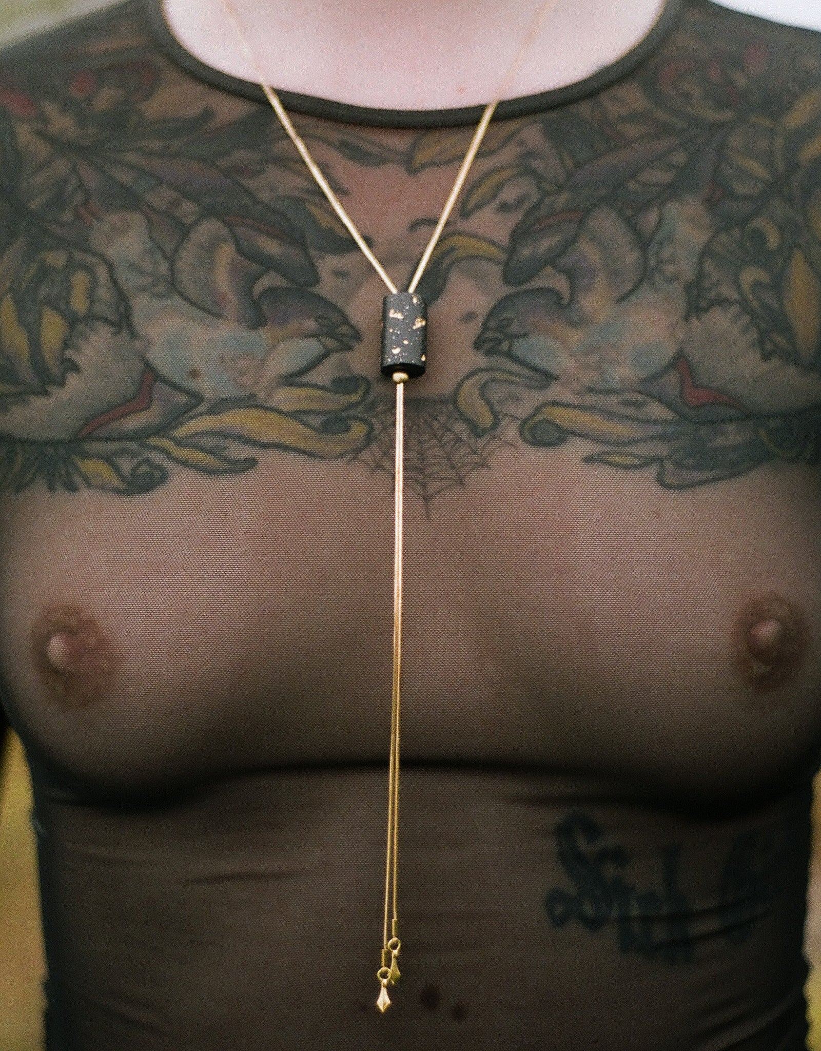 Gold foil bolo tie necklace on a model