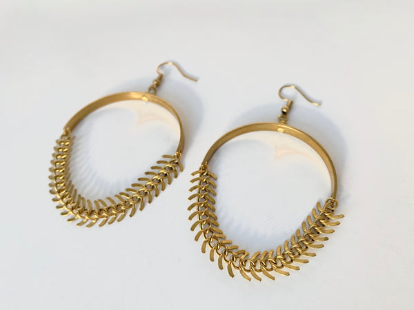 Side view of brass fishbone chain earrings