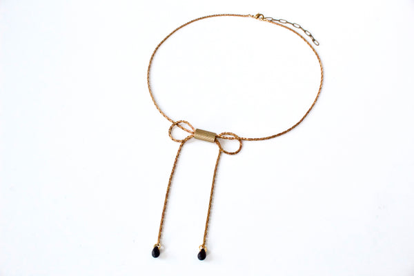 Gold bow choker necklace with black glass beads