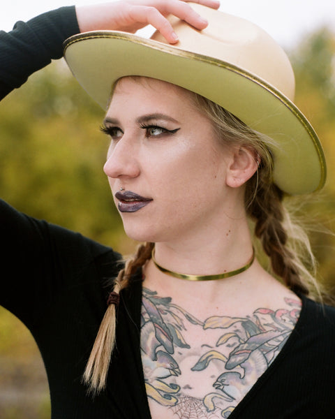 Day collar on a model wearing a cowboy hat