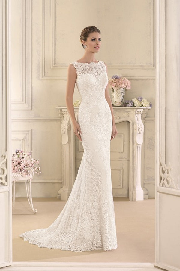 Astrid by Novia D'art is a gorgeous blush colour modern fitted lace wedding dress with a stunning open back and a lovely illusion neckline. Stunning designer discounted dress amazing quality for cheap sale price.