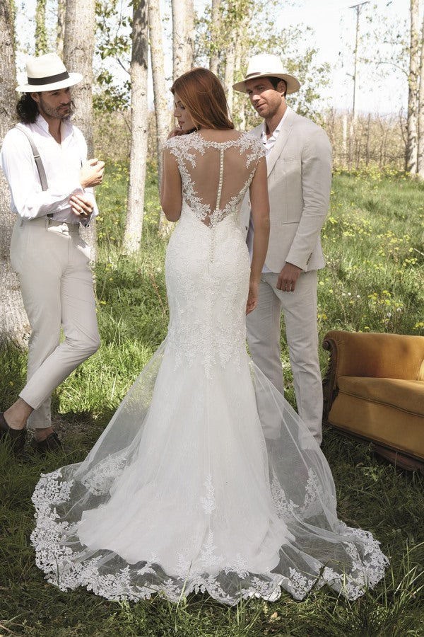 Carlotta by Novia D'art is a gorgeous lace fitted bridal gown featuring off the shoulder detail and a stunning illusion back. Stunning designer discounted dress amazing quality for cheap sale price.