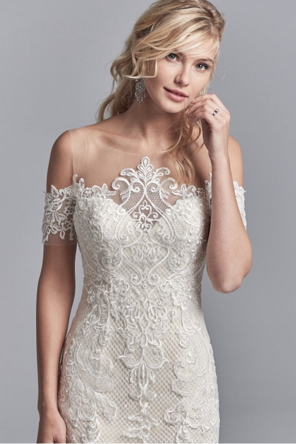 Sottero & Midgley Elin wedding dress combines gorgeous lace motifs over soft tulle and netting with the exquisite illusion neckline beautiful bardot sleeves and stunning illusion low back. Ivory over Champagne. Stunning designer discounted dress amazing quality for cheap sale price.