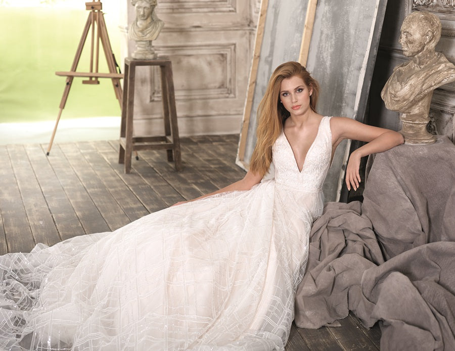 Fara Sposa 5237 is a ballgown with a plunge V neckline. It is made from the most amazing sparkly sequin fabric with champagne tones. This bridal gown is the perfect choice for a modern bride who wants to make a statement. Stunning designer discounted dress amazing quality for cheap sale price.