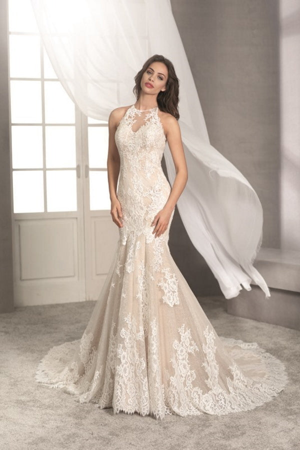Fara Sposa 5437 is a beautiful lace fitted fishtail/mermaid style wedding dress features a stunning illusion back and an amazing long lace train. Stunning designer discounted dress amazing quality for cheap sale price.