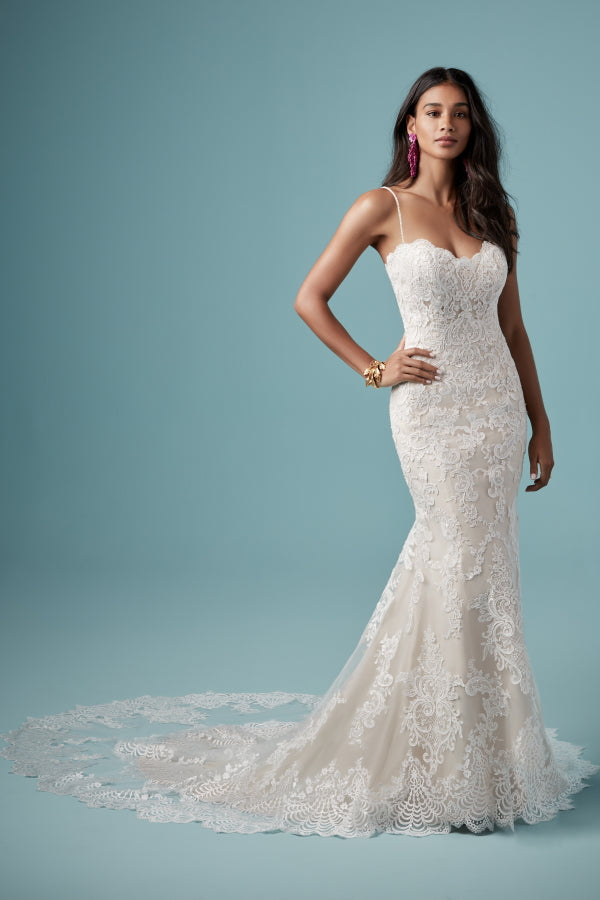 Kiera Wedding Dress by Maggie Sottero is a gorgeous lace softly fitted bridal gown with featuring sweetheart neckline, low back and a statement long lace double train. Excellent condition wedding gown. Stunning designer discounted dress amazing quality for cheap sale price.