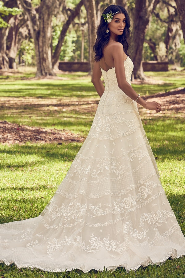 Maggie Sottero Renee A-line wedding dress features horizontal lace motifs atop tulle. Complete with strapless sweetheart neckline. Finished with inner shapewear and crystal buttons over zipper closure. Stunning designer discounted dress amazing quality for cheap sale price.