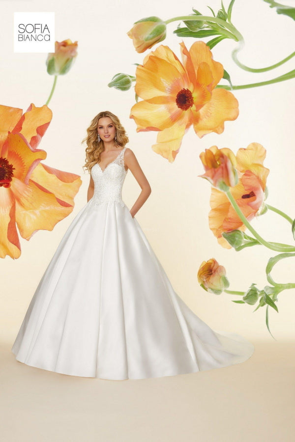 Sonata by Sofia Bianca is a traditional satin ball gown with an illusion back, V neckline and stunning frosted embroidered appliques. Stunning designer discounted dress amazing quality for cheap sale price.