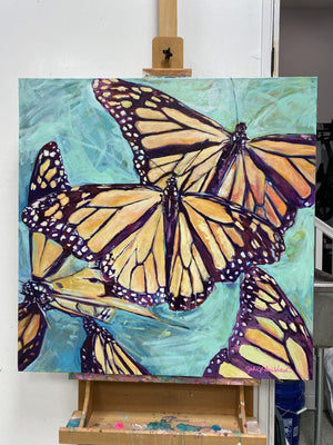 """Transformation Taking Flight"" Original 36x36"" on Large Canvas by Julie Davis Veach pictured on an easle in her studio"