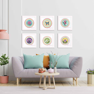 Set of six framed paintings from the Little Blessings collection by Julie Davis Veach displayed in a bright and colorful contemporary living room