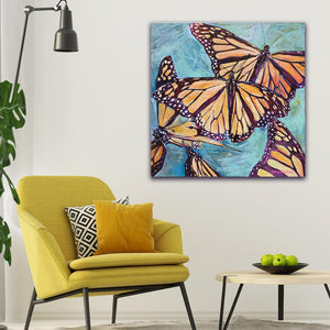 """Transformation Taking Flight"" Original 36x36"" on Large Canvas by Julie Davis Veach displayed in a bright colorful modern contemporary interior"