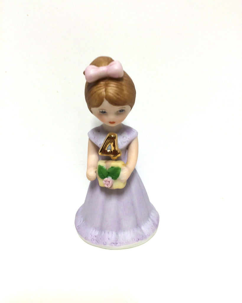 Brown haired girl dress is lilac with gold 4.