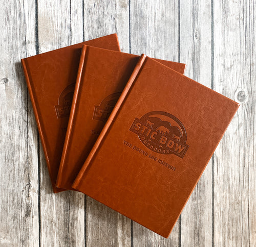three brown leather hunting journals