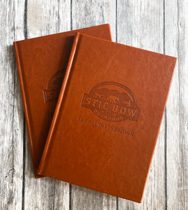 Two brown leather hunting journals