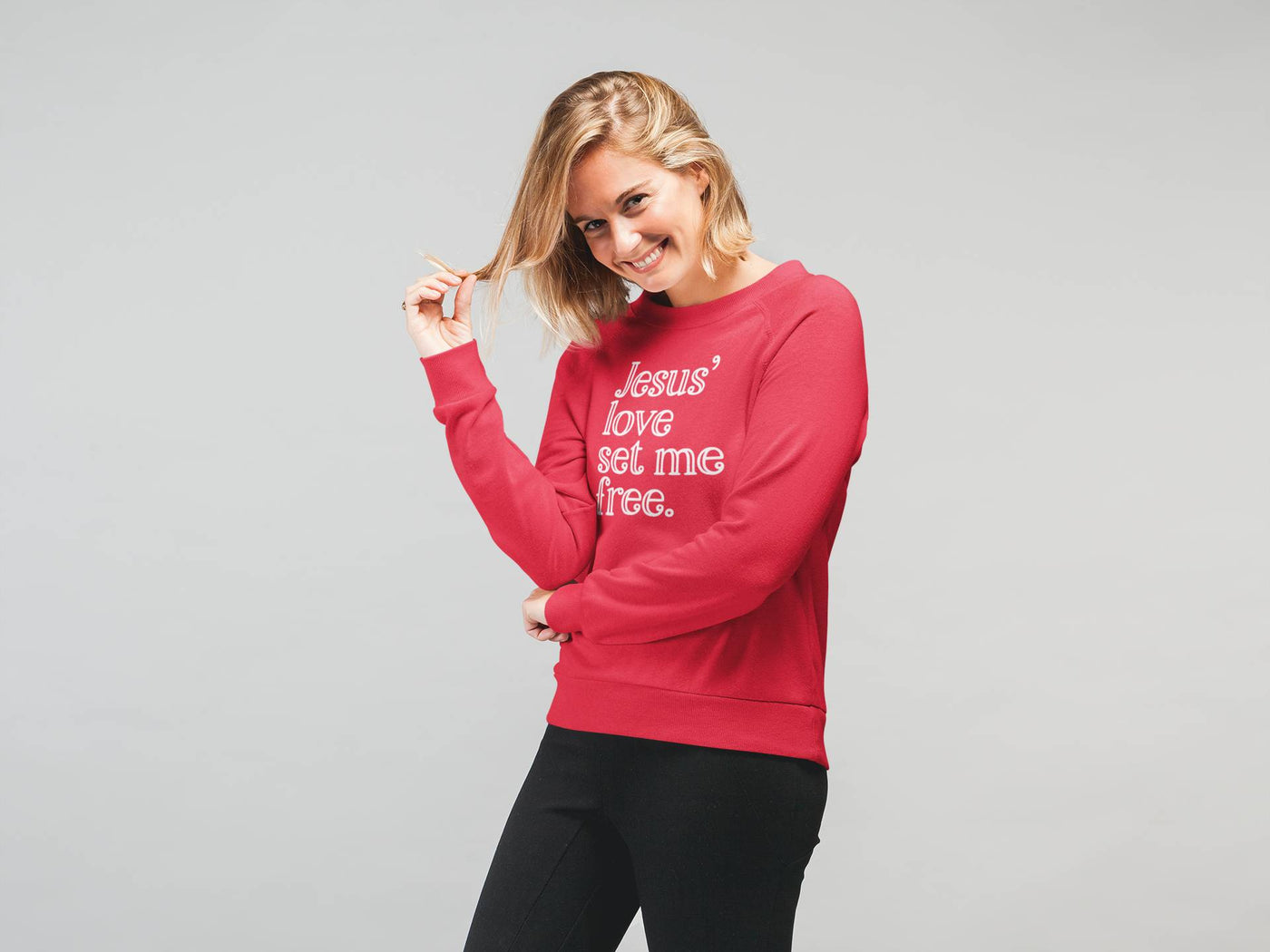happy woman wearing christian sweatshirt pulling hair
