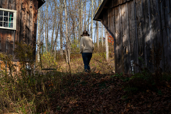 Lisa walks up to the barn, also known as lisa b. headquarters | lisa b.
