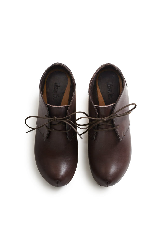 toe seam leather bootie clogs in dark brown