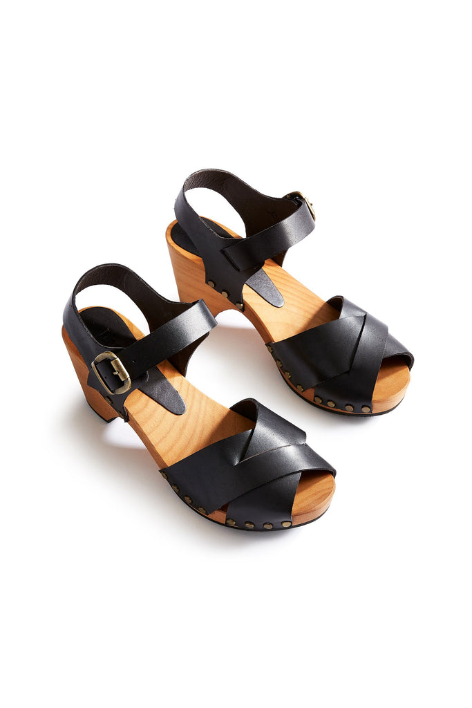 leather cross-over clogs in black