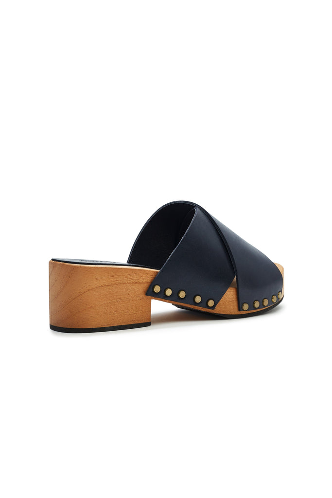 criss cross leather low heel clogs in dark navy
