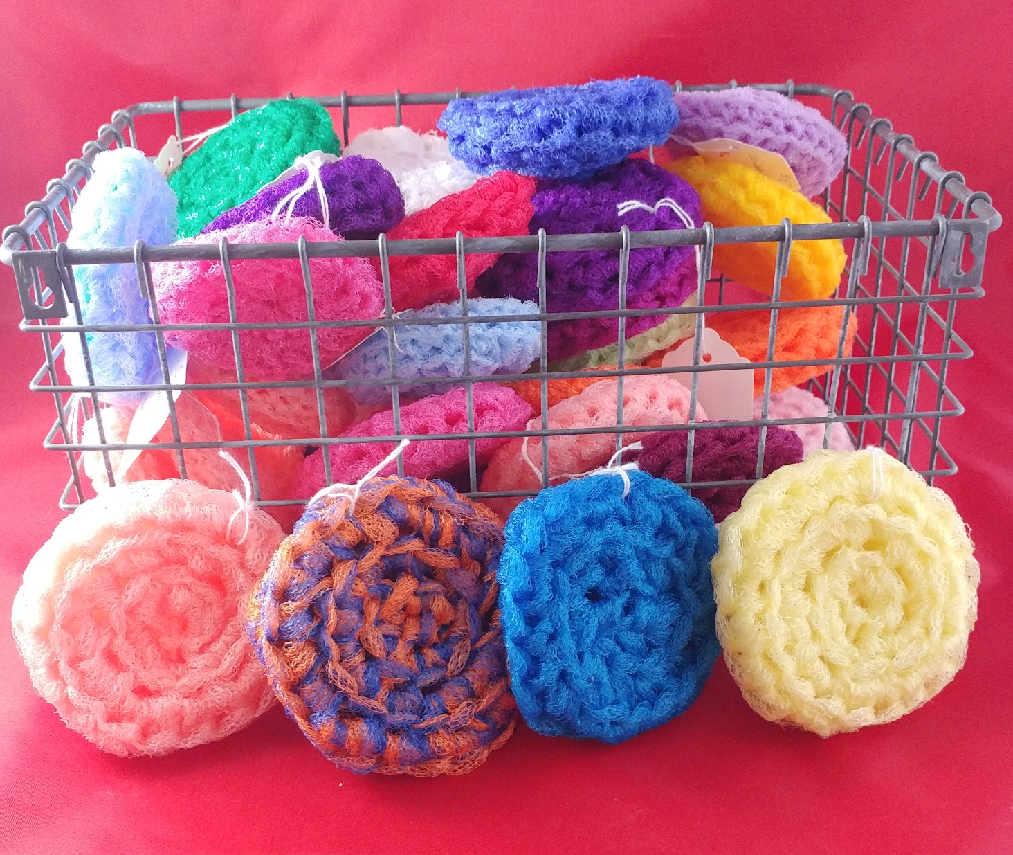 photo of wire basket of crocheted scrubbies in various colors