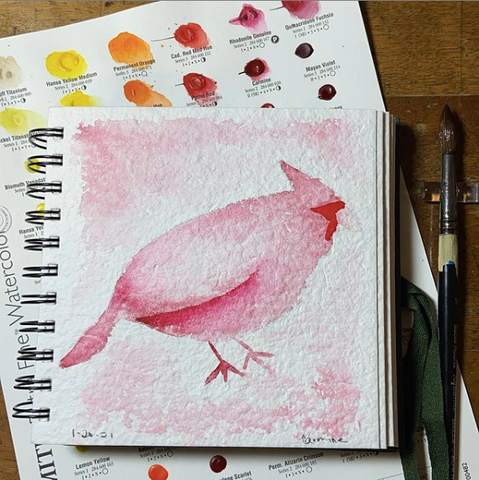 a fat watercolor cardinal in red