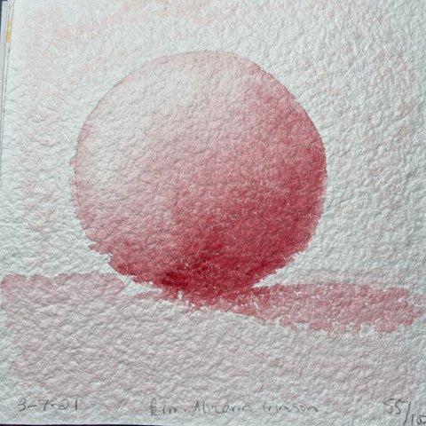 a sphere painted in red watercolor