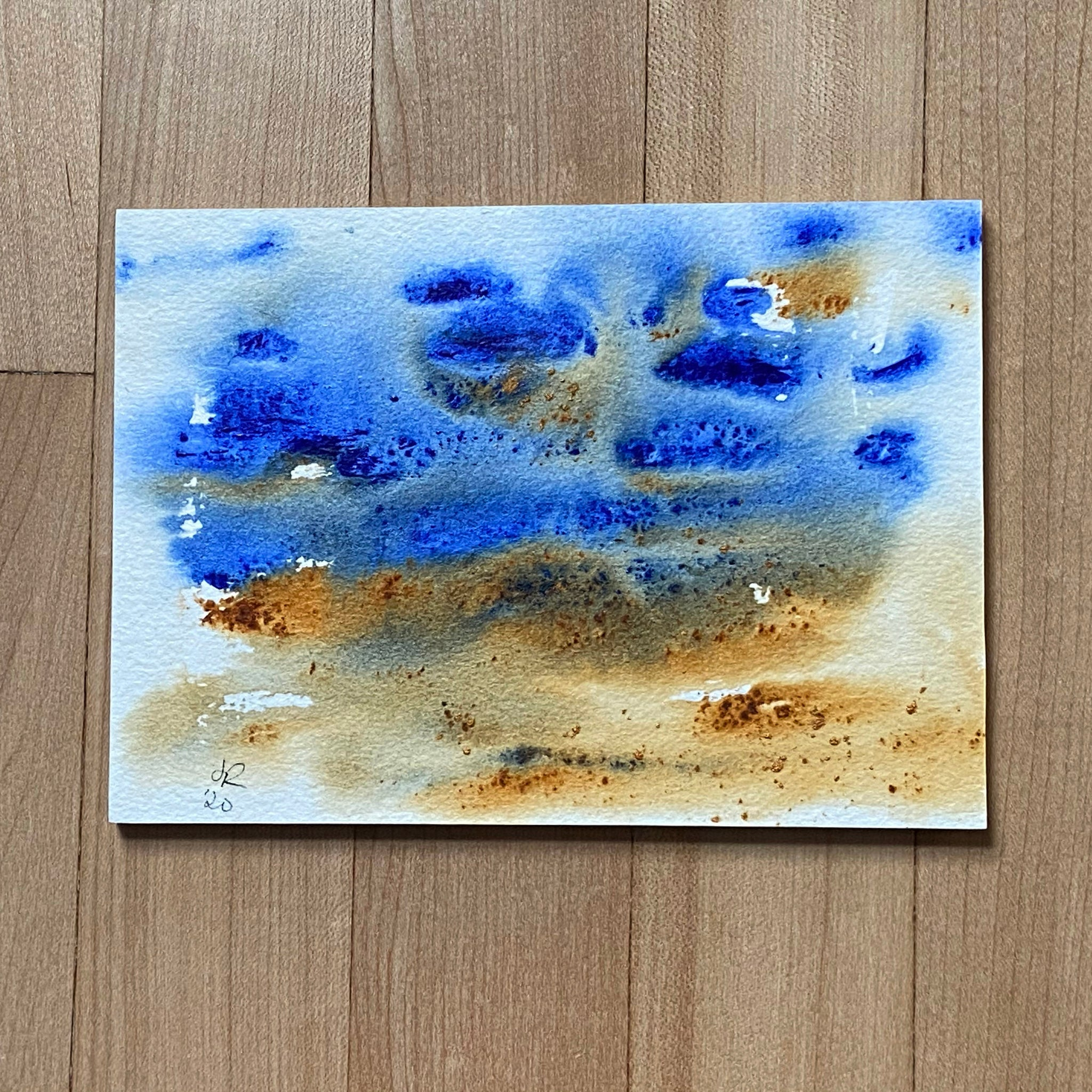 Abstract landscape in blue and sienna.
