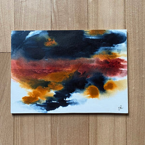 Abstract clouds in black, red, yellow mounted on small board.