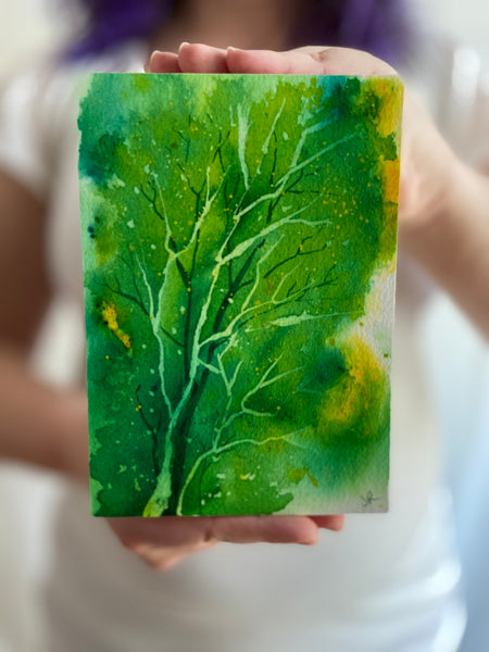 """Spring Greens"" original watercolor painting held for scale"